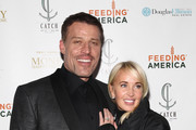 Life Coach Tony Robbins (L) and Sage Robbins attend DuJour Magazine's Jason Binn and Invicta Watches in the welcoming of Tony Robbins to New York at Catch NYC on November 17, 2014 in New York City.