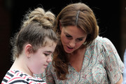 Catherine, Duchess of Cambridge talks to Ffion Turner during a photography workshop for Action for Children, run by the Royal Photographic Society at Warren Park on June 25, 2019 in Kingston, England.