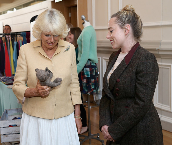 Camilla, Duchess of Cornwall is presented with a birthday present for Prince George of Cambridge as she browses stalls at the Fashion Festival in the Assembly Rooms on July 22, 2014 in Edinburgh, Scotland.