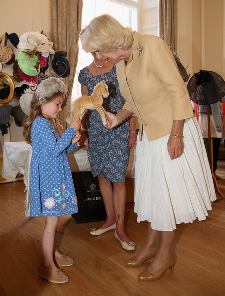Camilla, Duchess of Cornwall meets 7 year old Pickle Constance and her pet horse 'Pearl' as she browses stalls at the Fashion Festival in the Assembly Rooms on July 22, 2014 in Edinburgh, Scotland.