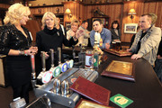 Camilla, The Duchess of Cornwall (2L) meets actors Beverley Callard, who plays landlady Liz McDonald (L), Anne Kirkbride, who plays the role of Deirdre Barlow (C) and Ryan Thomas, who plays the role of Jason Grimshaw (2nd R) during a tour to the Rovers Return Pub on the set of British television soap opera 'Coronation Street' on February 4, 2010 in Manchester, England.