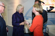 Camilla, Duchess of Cornwall meets Anthony Horowitz and Kate Mosse during an official visit to The London Book Fair at Earls Court on April 9, 2014 in London, England.