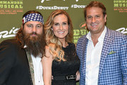 """(L-R) Television personalities Willie Robertson and Korie Robertson and director Jeff Calhoun attend the """"Duck Commander Musical"""" premiere at the Crown Theater at the Rio Hotel & Casino on April 15, 2015 in Las Vegas, Nevada. The musical is based on the book """"The Duck Commander Family: How Faith, Family, and Ducks Built a Dynasty"""" by Willie and Korie Robertson from the television show """"Duck Dynasty."""""""