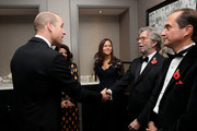 Prince William, Duke of Cambridge with Eric Clapton and guests as he attend the London's Air Ambulance Charity gala at Rosewood London on November 07, 2019 in London, England. Prince William is Patron of London's Air Ambulance Charity's 30th Anniversary Campaign.
