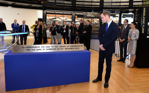 Prince William, Duke of Cambridge unveils a plaque to commemorate his visit to Birmingham Library on November 29, 2013 in Birmingham, England.