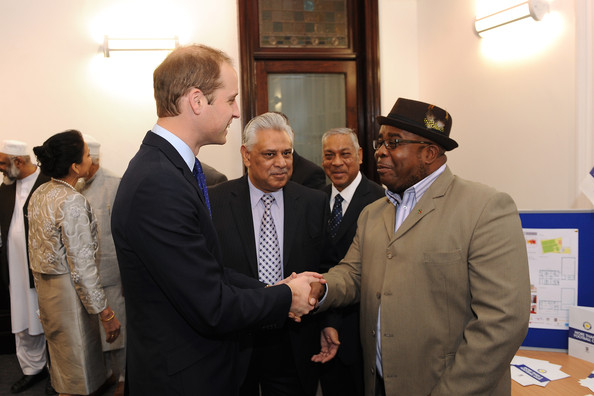 Prince William, Duke of Cambridge meets Lincoln Moses, general manager of Continental Star FC during his visit to South and City College on November 29, 2013 in Birmingham, England.