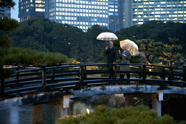 Prince William, Duke of Cambridge walks over a traditional Japanese bridge in Hama Rikyu Gardens with Tokyo Governor Yoichi Masuzoe on the first day of his visit to Japan on February 26, 2015 ino Tokyo, Japan. The Duke of Cambridge is visiting Japan from February 26th to March 1st 2015.