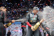 Sir Ben Ainslie and the Land Rover BAR team celebrate winning the America's Cup 2016 on stage at the America's Cup World Series on July 24, 2016 in Portsmouth, England.