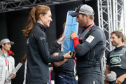 Catherine, Duchess of Cambridge presents Sir Ben Ainslie with the America's Cup 2016 trophy on stage at the America's Cup World Series on July 24, 2016 in Portsmouth, England.