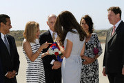 Anne Gust, wife of California Governor Jerry Brown, gives a red white and blue bouquet of flowers to Catherine, Duchess of Cambridge after she and Prince William, Duke of Cambridge, arrive at Los Angeles International Airport on July 8, 2011 in Los Angeles, California. Looking on are Mayor of Los Angeles Antonio Villaraigosa (L), Calfornia Governor Jerry Brown and British Ambassador Sir Nigel Sheinwald (R). The newly married Royal Couple are on a three day visit to Southern California.