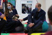 Prince William, Duke of Cambridge and Catherine, Duchess of Cambridge handle Milly the rabbit as they join a group of local school children from Loxdale Primary School during a visit to HugglePets in the Community to mark mental health awareness week on May 13, 2021 in Wolverhampton, England. HugglePets in the Community works with over 25 different schools in the Black Country, offering Animal Assisted Intervention programmes supporting children with their mental wellbeing on topics including anxiety, low mood, confidence and resilience building and suicide awareness.