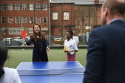 Prince William, Duke of Cambridge and Catherine, Duchess of Cambridge play table tennis during a visit to The Way Youth Zone on May 13, 2021 in Wolverhampton, England.