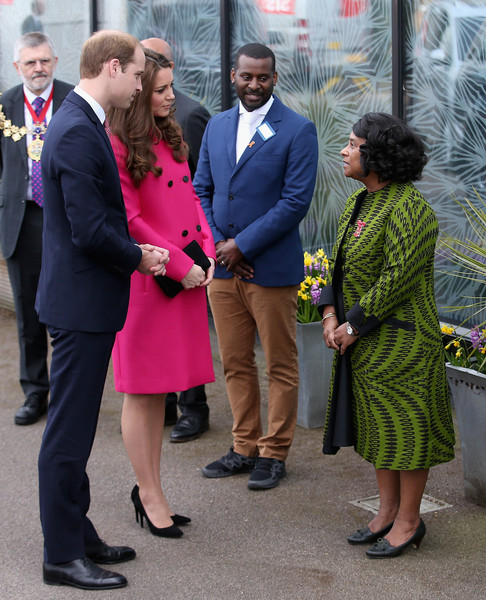 Prince William, Duke of Cambridge and Catherine, Duchess of Cambridge chat to Baroness Lawrence of Clarendon as they arrive at the Stephen Lawrence Centre on March 27, 2015 in London, England.