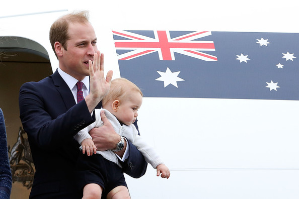 Prince William, Duke of Cambridge and Prince George of Cambridge wave to the crowd before boarding a Royal Australian Air Force plane for their flight to Australia at Wellington Airport's military terminal April 16, 2014 in Wellington, New Zealand. The Duke and Duchess of Cambridge are on a three-week tour of Australia and New Zealand, the first official trip overseas with their son, Prince George of Cambridge.