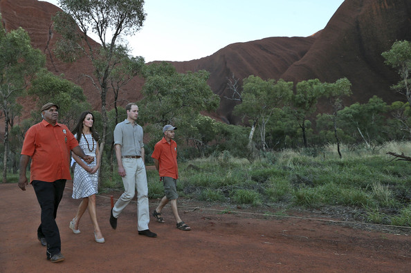 Catherine, Duchess of Cambridge and Prince William, Duke of Cambridge are guided by John Sweeney right and Sammy Wilson left, along the Kuniya walk at Uluru on April 22, 2014 in Ayers Rock, Australia. The Duke and Duchess of Cambridge are on a three-week tour of Australia and New Zealand, the first official trip overseas with their son, Prince George of Cambridge.