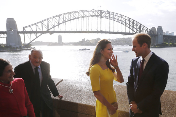 Prince William, Duke of Cambridge (R) and Catherine, Duchess of Cambridge (2nd R) pose for a photo in front of the Sydney Harbour Bridge as New South Wales Governor Marie Bashir (L) and Sir Nicholas Shehadie look on during a reception at the Sydney Opera House on April 16, 2014 in Sydney, Australia. The Duke and Duchess of Cambridge are on a three-week tour of Australia and New Zealand, the first official trip overseas with their son, Prince George of Cambridge.