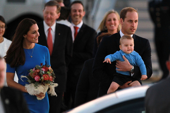 Catherine Duchess of Cambridge walks with Prince William, Duke of Cambridge carrying Prince George of Cambridge as the Royal Family arrive at Fairbairn Airport on April 20, 2014 in Canberra, Australia. The Duke and Duchess of Cambridge are on a three-week tour of Australia and New Zealand, the first official trip overseas with their son, Prince George of Cambridge.