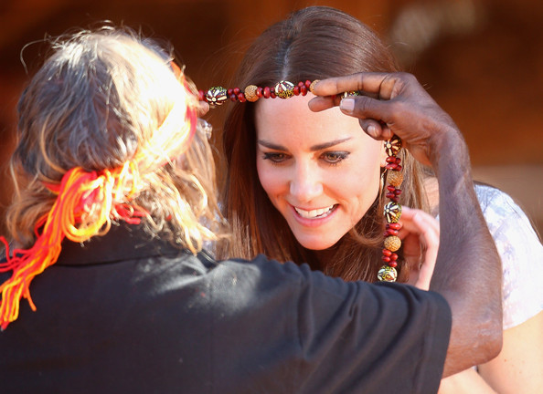 Catherine, Duchess of Cambridge is presented with a necklace at Uluru-Kata Tjuta Cultural Centre on April 22, 2014 in Ayers Rock, Australia. The Duke and Duchess of Cambridge are on a three-week tour of Australia and New Zealand, the first official trip overseas with their son, Prince George of Cambridge.