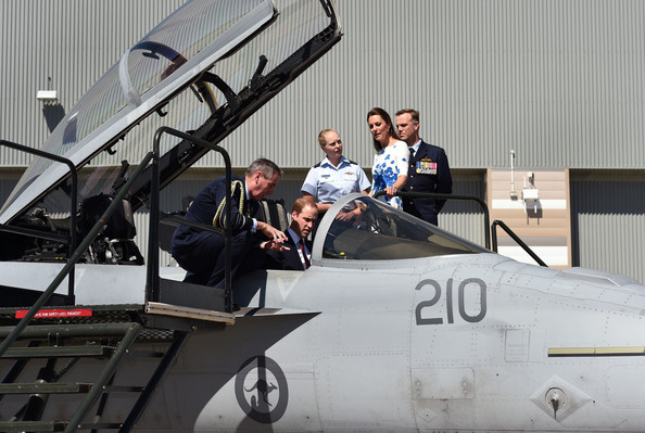 Chief of Air Force, Air Marshal Geoff Brown (L) chats with Prince William, Duke of Cambridge (2nd L) sitting in the cockpit of a RAAF Super Hornet of 1 Squadron as his wife Catherine, the Duchess of Cambridge (2nd R), Commanding Officer of Number 1 Squadron , Wing Commander Stephen Chappell (R), and Flight Lieutenant Jasmine Richards (C) look on at the Royal Australian Airforce Base at Amberley on April 19, 2014 in Brisbane, Australia. The Duke and Duchess of Cambridge are on a three-week tour of Australia and New Zealand, the first official trip overseas with their son, Prince George of Cambridge.