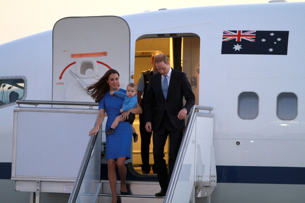 Catherine, Duchess of Cambridge, Prince William, Duke of Cambridge and their son Prince George of Cambridge arrive at Fairbairn Airport on April 20, 2014 in Canberra, Australia. The Duke and Duchess of Cambridge are on a three-week tour of Australia and New Zealand, the first official trip overseas with their son, Prince George of Cambridge.