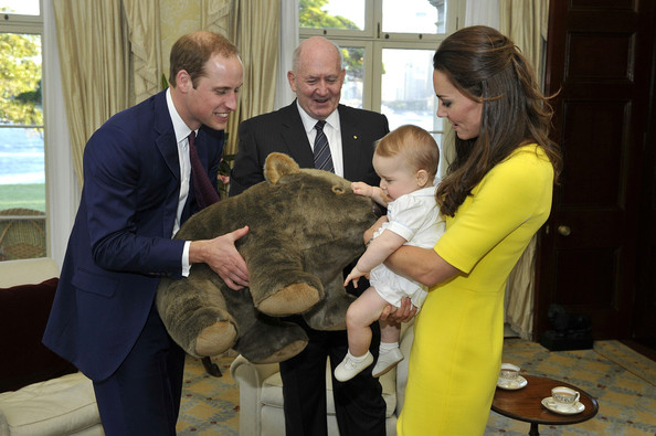 In this handout image supplied by Admiralty House, the official Sydney residence of the Governor-General, Prince George of Cambridge, with his parents Prince William, Duke of Cambridge and Catherine, Duchess of Cambridge, receives a gift from the Governor-General Sir Peter Cosgrove at Admiralty House, on April 16, 2014 in Sydney, Australia. The Duke and Duchess of Cambridge are on a three-week tour of Australia and New Zealand, the first official trip overseas with their son, Prince George of Cambridge.