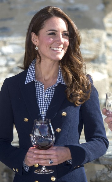 Catherine Duchess of Cambridge takes part in wine tasting during a visit to the Amisfield Winery on April 13, 2014 in Queenstown, New Zealand. The Duke and Duchess of Cambridge are on a three-week tour of Australia and New Zealand, the first official trip overseas with their son, Prince George of Cambridge.
