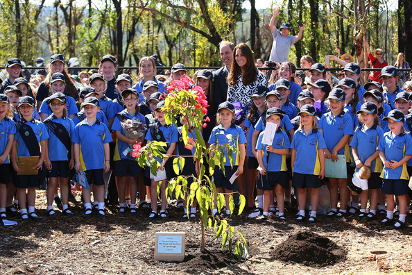 Prince William, Duke of Cambridge and Catherine, Duchess of Cambridge pose for a photo with Girl Guides after planting a tree at the Winmalee Guide Hall on April 17, 2014 in Winmalee, Australia. The Duke and Duchess of Cambridge are on a three-week tour of Australia and New Zealand, the first official trip overseas with their son, Prince George of Cambridge.