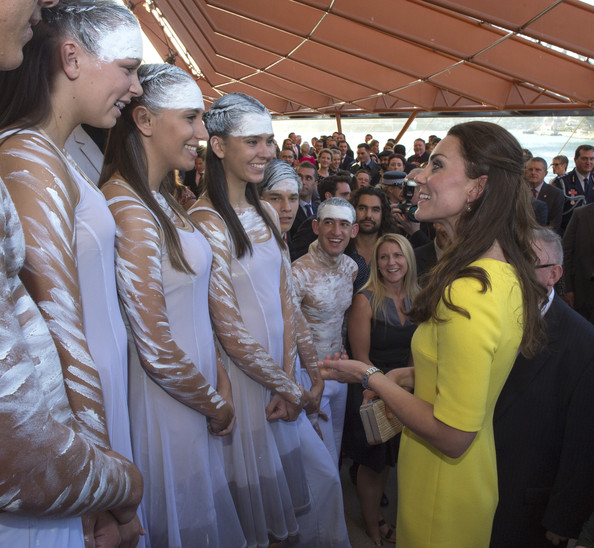 Catherine, Duchess of Cambridge meets the aboriginal dancers as she attends a reception hosted by the Governor and Premier of New South Wales on April 16, 2014 in Sydney, Australia. The Duke and Duchess of Cambridge are on a three-week tour of Australia and New Zealand, the first official trip overseas with their son, Prince George of Cambridge.