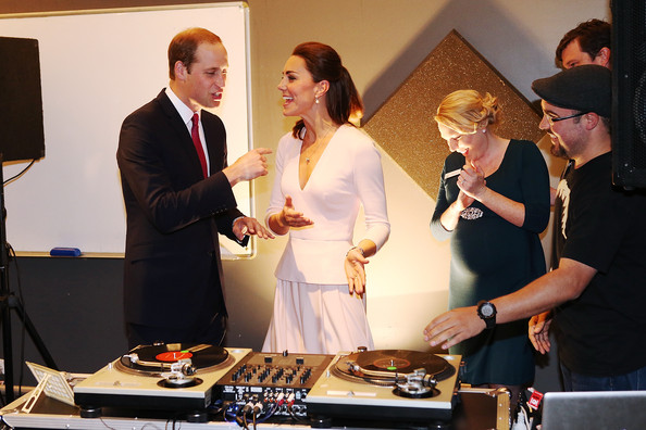 Catherine, Duchess of Cambridge gestures to Prince William, Duke of Cambridge to play on DJ decks at the Northern Sound System on April 23, 2014 in Adelaide, Australia. The Duke and Duchess of Cambridge are on a three-week tour of Australia and New Zealand, the first official trip overseas with their son, Prince George of Cambridge.