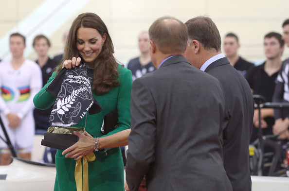 Catherine, Duchess of Cambridge receives a cycling jersey for Prince George at the opening of new National Cycling Centre of Excellence and Velodrome on April 12, 2014 in Cambridge, New Zealand. The Duke and Duchess of Cambridge are on a three-week tour of Australia and New Zealand, the first official trip overseas with their son, Prince George of Cambridge.