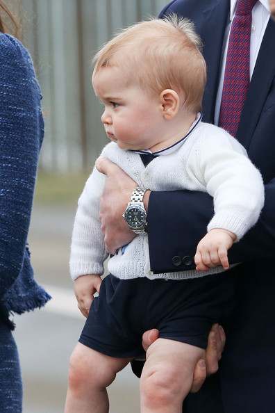 Prince George of Cambridge is carried to a Royal Australian Air Force plane for his flight to Australia at Wellington Airport's military terminal April 16, 2014 in Wellington, New Zealand. The Duke and Duchess of Cambridge are on a three-week tour of Australia and New Zealand, the first official trip overseas with their son, Prince George of Cambridge.