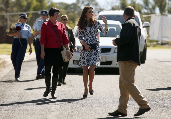 Catherine, Duchess of Cambridge (C) walks with officials and security staff down a road in the Blue Mountains suburb of Winmalee that lost homes during bushfires last year, on April 17, 2014 in Katoomba, Australia. The Duke and Duchess of Cambridge are on a three-week tour of Australia and New Zealand, the first official trip overseas with their son, Prince George of Cambridge.