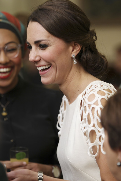 Catherine, Duchess of Cambridge laughs with guests at a reception hosted by the Governor General Peter Cosgrove and Her excellency Lady Cosgrove at Government House on April 24, 2014 in Canberra, Australia. The Duke and Duchess of Cambridge are on a three-week tour of Australia and New Zealand, the first official trip overseas with their son, Prince George of Cambridge.