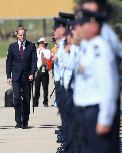 Prince William, Duke of Cambridge inspects an honour Guard as he arrives at the Royal Australian Airforce Base at Amberley on April 19, 2014 in Brisbane, Australia. The Duke and Duchess of Cambridge are on a three-week tour of Australia and New Zealand, the first official trip overseas with their son, Prince George of Cambridge.