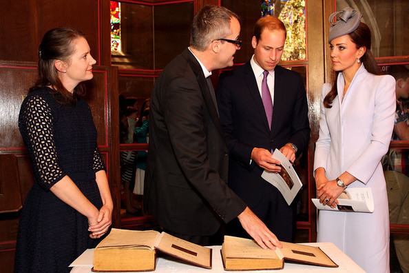 Prince William, Duke of Cambridge (2nd R) and Catherine, Duchess of Cambridge (R) prepare to sign the First Fleet Bible and Prayer Book following Easter Sunday Service at St Andrews Cathedral on April 20, 2014 in Sydney, Australia. The Duke and Duchess of Cambridge are on a three-week tour of Australia and New Zealand, the first official trip overseas with their son, Prince George of Cambridge.