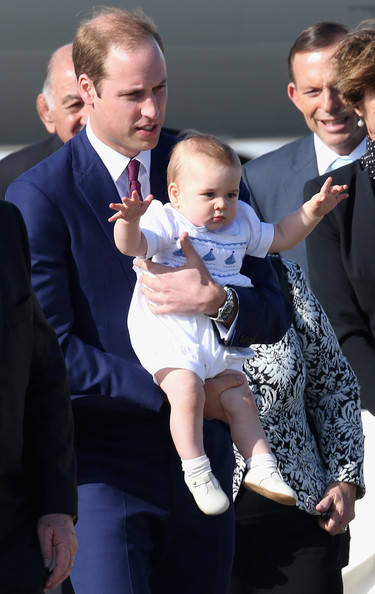 Prince William, Duke of Cambridge carries  Prince George of Cambridge as they arrive at Sydney Airport on a Australian Airforce 737 aircraft on April 16, 2014 in Sydney, Australia. The Duke and Duchess of Cambridge are on a three-week tour of Australia and New Zealand, the first official trip overseas with their son, Prince George of Cambridge.