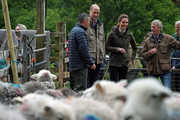 Prince William, Duke of Cambridge and Catherine, Duchess of Cambridge with Chris Brown and Jimmy Brown at Deepdale Hall Farm, a traditional fell sheep farm, in Patterdale during a visit to Cumbria on June 11, 2019 in Patterdale, England. The royal couple are joining a celebration to recognise the contribution of individuals and local organisations in supporting communities and families across Cumbria.