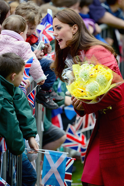 Catherine, Duchess of Cambridge greets fans at MacRostyy Park on May 29, 2014 in Crieff, Scotland. The Duke and Duchess of Cambridge will spend today in Scotland where they will tour adistillery and visit a village fete.