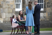 Prince William, Duke of Cambridge and Catherine, Duchess of Cambridge and Mila Sneddon, 5, with her sister Jodi, and parents Lynda and Scott Sneddon, who are special guests of the Duke and Duchess, during a Beating of the Retreat at the Palace of Holyroodhouse on May 27, 2021 in Edinburgh, Scotland. Cancer patient Mila features in an image from the Hold Still photography project which showed her kissing her father Scott through a window whilst she was shielding during her chemotherapy treatment.