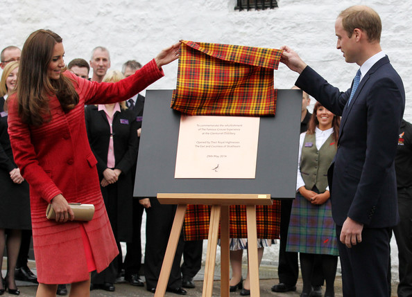 Catherine, Duchess of Cambridge and Prince William, Duke of Cambridge unveil a plaque during a tour of The Famous Grouse Distillery on May 29, 2014 in Crieff, Scotland. The Duke and Duchess of Cambridge will spend the day in Scotland where they will tour a distillery and visit a village fete.