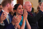Prince Harry, Duke of Sussex and Meghan, Duchess of Sussex sitting next to Ross Kemp cheer on a wedding proposal as they attend the annual Endeavour Fund Awards at Mansion House on March 5, 2020 in London, England. Their Royal Highnesses will celebrate the achievements of wounded, injured and sick servicemen and women who have taken part in remarkable sporting and adventure challenges over the last year.