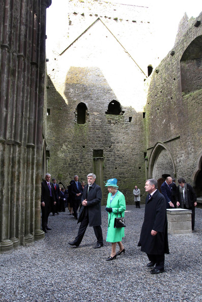 Duke of Edinburgh Queen Elizabeth II visit the nave of the Cathedral at the Rock of Cashel accompanied by Minister for Public Expenditure and Reform Brendan Howlin TD and Dr Eugene Keane as and Prince Philip, Duke of Edinburgh speaks to Head Curator Aighleann O'Shaughnessy on May 20, 2011 in Cashel, Ireland. The Duke and Queen are on a historic four-day tour of the Republic of Ireland amid tight security, the first visit to Ireland by a British monarch since 1911. Republican dissident groups have made it clear they are intent on disrupting proceedings.