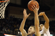 Kyle Singler #12 of the Duke Blue Devils drives to the basket against Ty Walker #40 of the Wake Forest Demon Deacons at Lawrence Joel Coliseum on January 22, 2011 in Winston Salem, North Carolina.