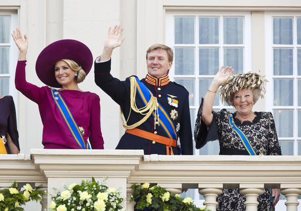 Queen Beatrix, Crown Prince Willem Alexander and Princess Maxima of The Netherlands wave from the Noordeinde Palace balcony after attending Budget Day announcement on September 18, 2012 in The Hague, Netherlands.