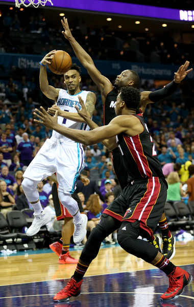 Miami Heat v Charlotte Hornets - Game Six [photograph,basketball,sports,basketball moves,basketball player,team sport,ball game,tournament,player,sport venue,courtney lee,user,dwyane wade 3,six,basket,charlotte hornets,miami heat,game,quarterfinals]