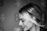 Image has been converted to black and white) Margot Robbie attends the EE British Academy Film Awards 2020 at Royal Albert Hall on February 02, 2020 in London, England.