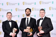 """(L to R) Greg Butler, Guillaume Rocheron and Dominic Tuohy, winners of the Best Special Visual Effects for """"1917"""", pose in the Winners Room during the EE British Academy Film Awards 2020 at Royal Albert Hall on February 02, 2020 in London, England."""