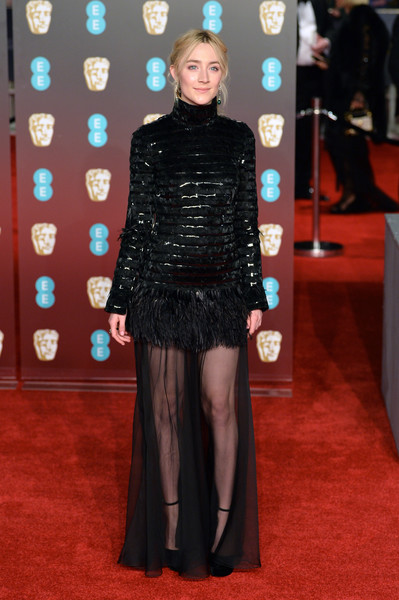 Saoirse Ronan looked fierce in a sheer-bottom, feather-adorned gown by Chanel at the EE British Academy Film Awards.
