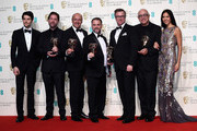 Colin Morgan (L) and Sonoya Mizuno (R) pose with Chris Duesterdiek, Martin Hernandez, Frank A. Montano, Jon Taylor and Randy Thom, winners of the Sound award for 'The Revenant', pose in the winners room at the EE British Academy Film Awards at the Royal Opera House on February 14, 2016 in London, England.