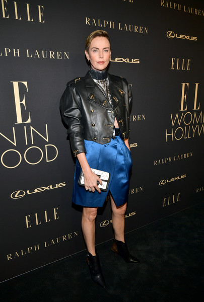 Charlize Theron went military-chic in a black Louis Vuitton leather jacket with gold-tone hardware at the 2019 Elle Women in Hollywood celebration.